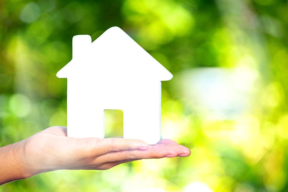 world-habitat-day-model-house-on-hand_ed