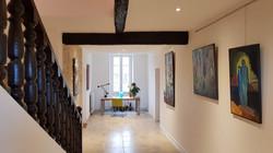 Hallway to bedrooms with art