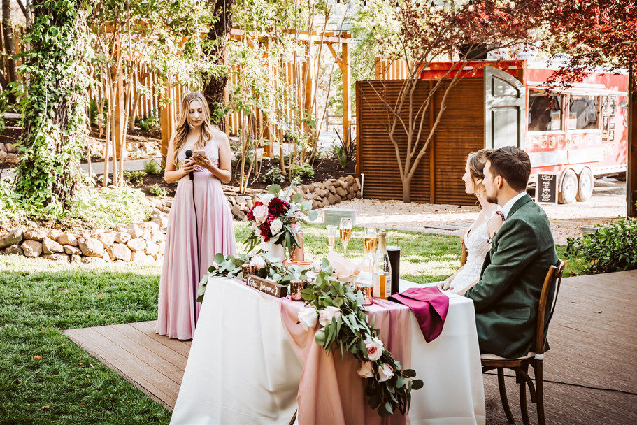A bridesmaid giving a speak during a wedding at Gardens of Sutter Creak