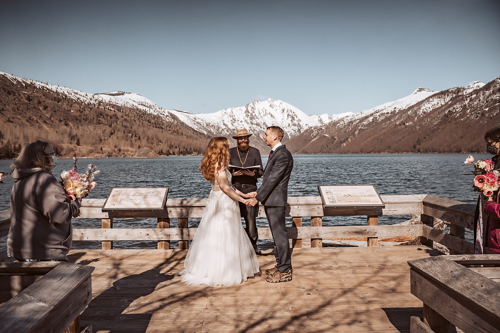 A intimate wedding ceremony in front of a snowy backdrop at Mt. St. Helens for an elopement