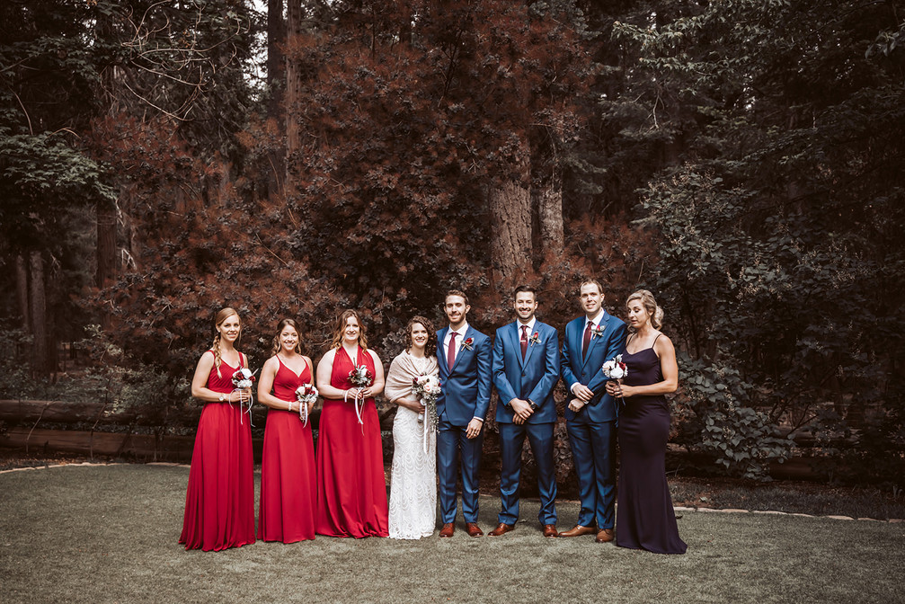The bridal party standing in front of the forest trees at the Harmony Ridge Lodge in Nevada City for their wedding day