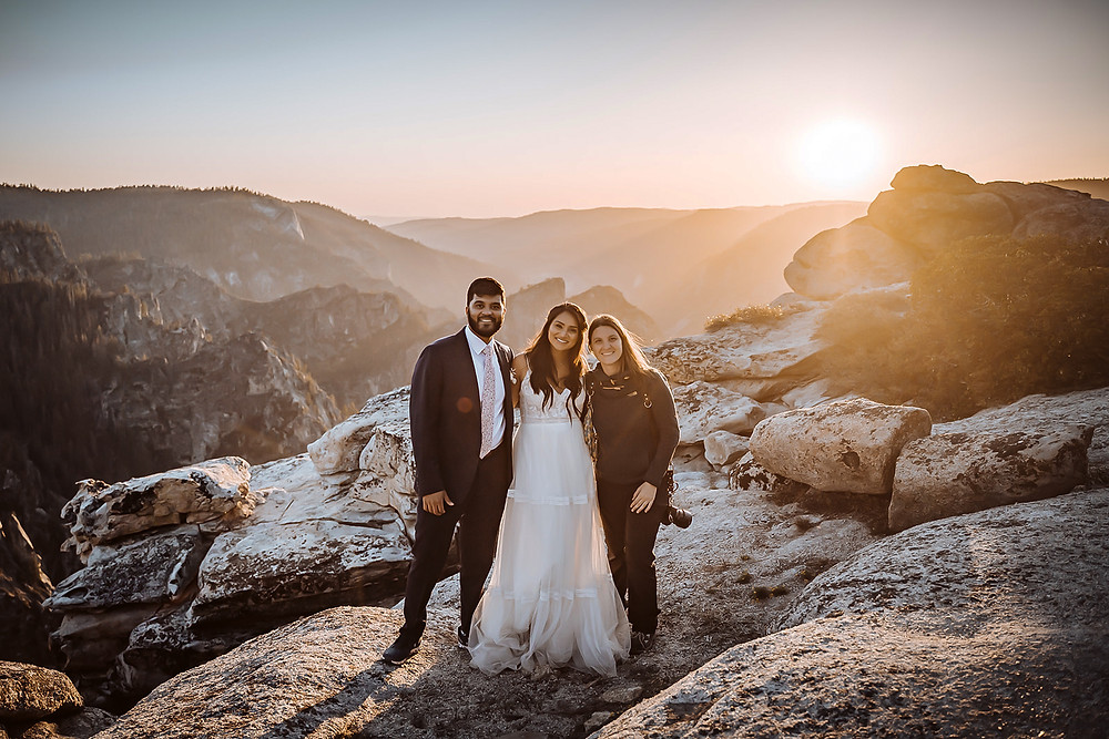 An elopement videographer standing with their couple on their adventure wedding day in Yosemite