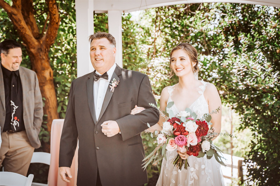 A father walking his daughter down the aisle at the Gardens of Sutter Creak