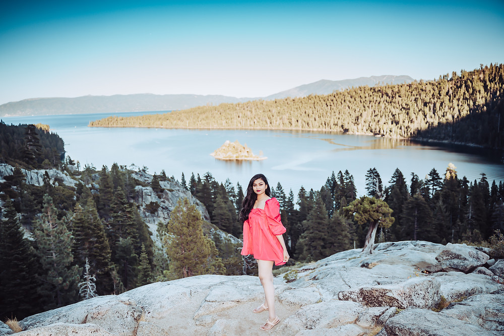 a girl standing in front of Emerald Bay in Lake Tahoe