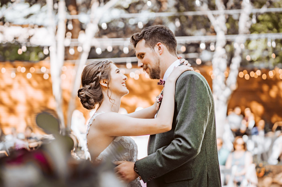 A wedding couples first dance with twinkling lights in the backdrop at Gardens of Sutter Creak, California