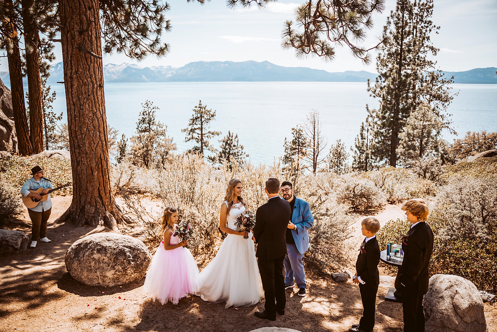 A intimate wedding ceremony included a couple children and a live musician overlooking Lake Tahoe