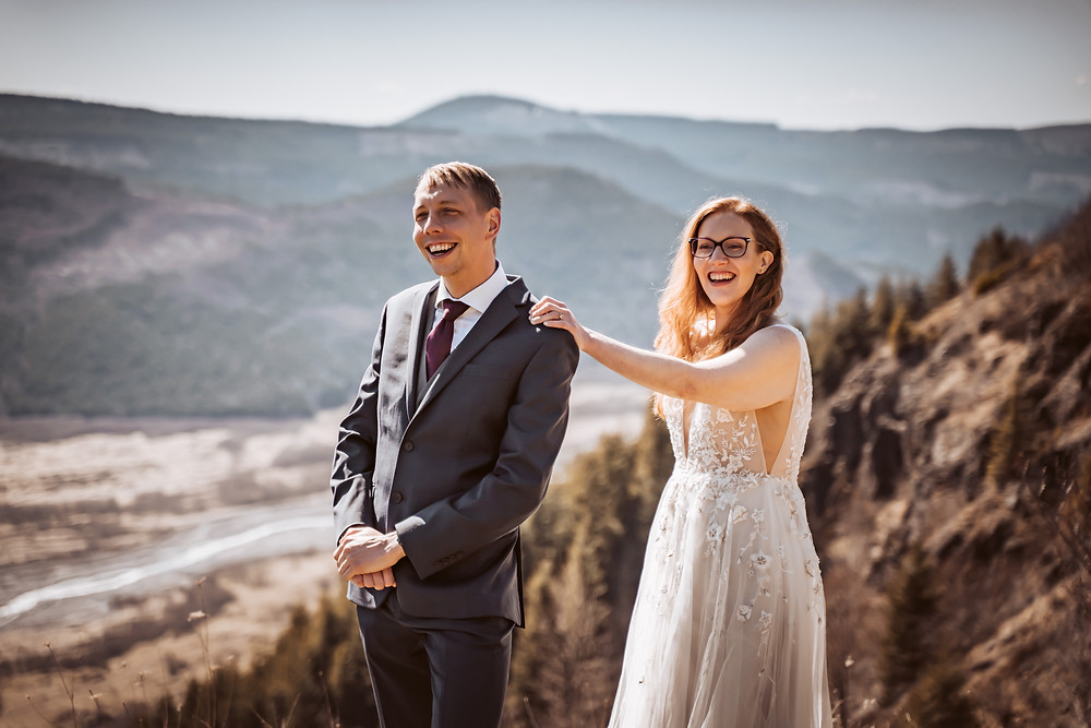A bride and groom doing a first look in front of a mountain range in Washington for their first look on their elopement timeline
