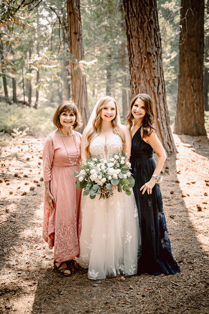 A 3 generations picture of a bride, her Mom and her Grandmother in the forest