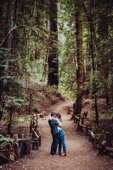 a Couple hugging in the middle of a hiking path at the Armstrong Redwoods State Park in Northern California on their Mini Moon