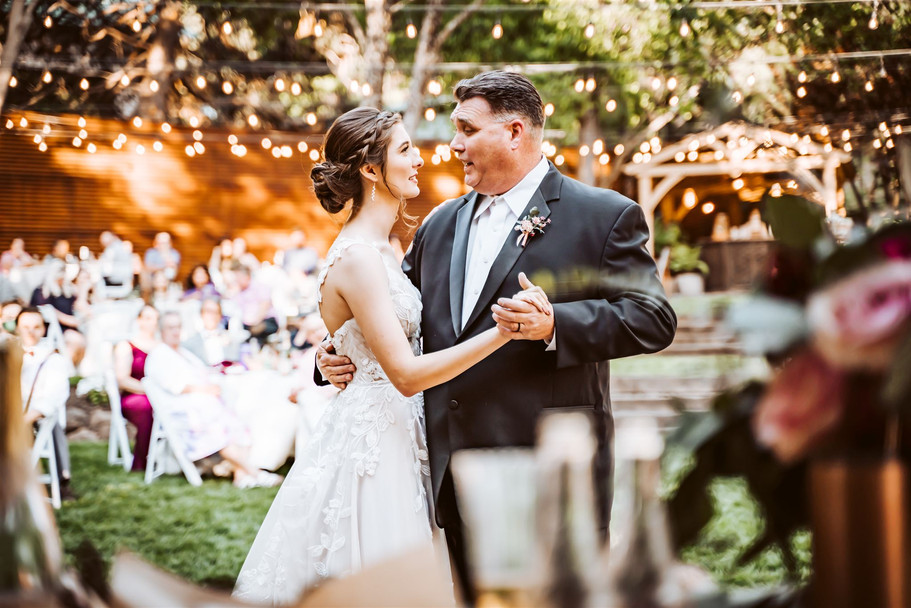 A father and a bride for their first dance under twinkling lights at the Garden of Sutter Creak, California