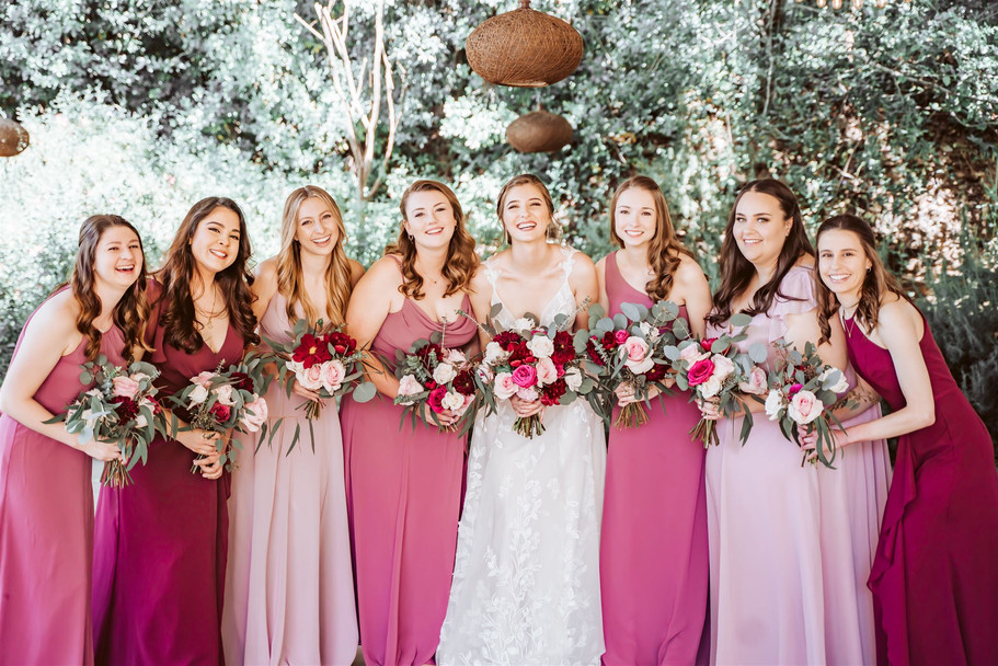 The bridal party in pink dresses with pink bouquets for their wedding at Gardens of Sutter Creak, California