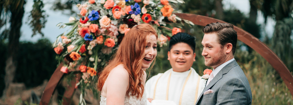 A bride laughing during her ceremony for her Northern California Intimate Wedding
