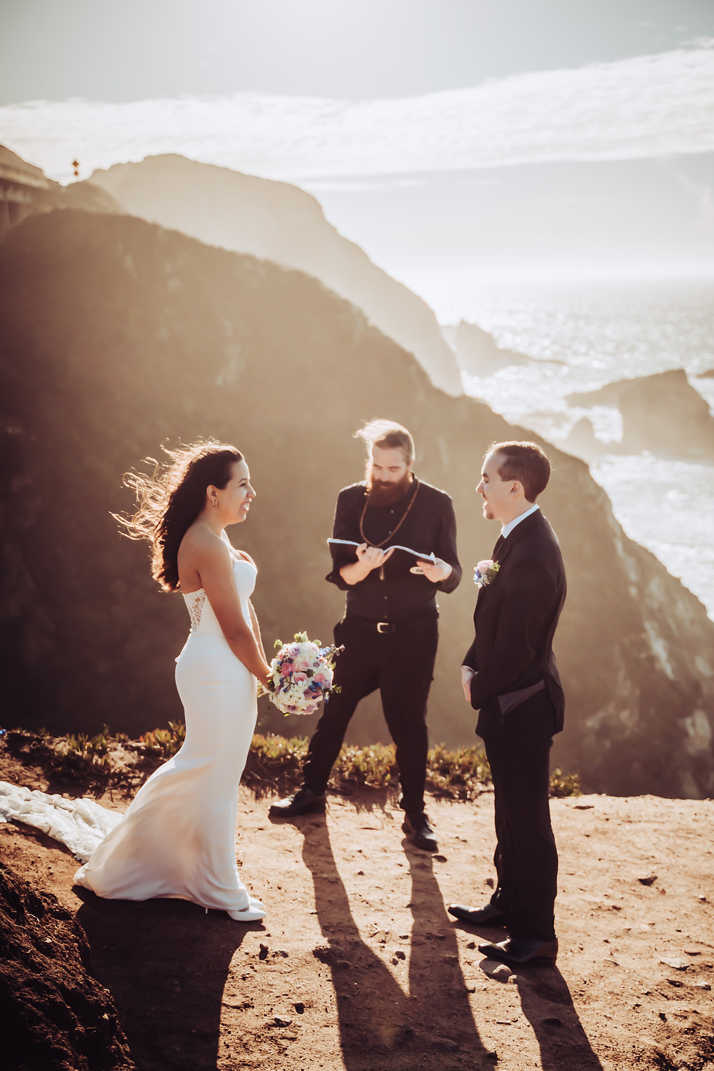 A wedding ceremony on the cliffs of Big Sur at Sunset for a couples California Elopement