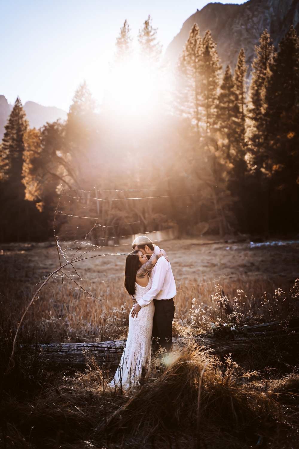 This couple decided to elope in Yosemite in the meadow under a sunset set.  In this picture they are hugging after their ceremony dressed in wedding attire