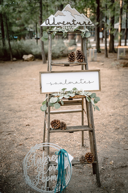 A wedding display featuring a mountain that says Adventure Awaits and Soulmates