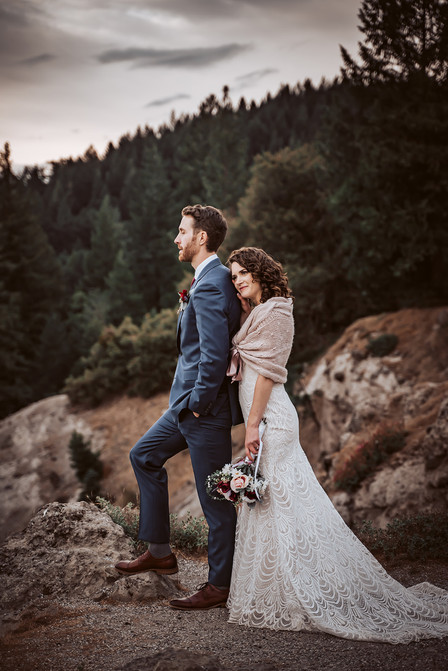 A bride and groom looking out onto the mountains of California for their wedding day