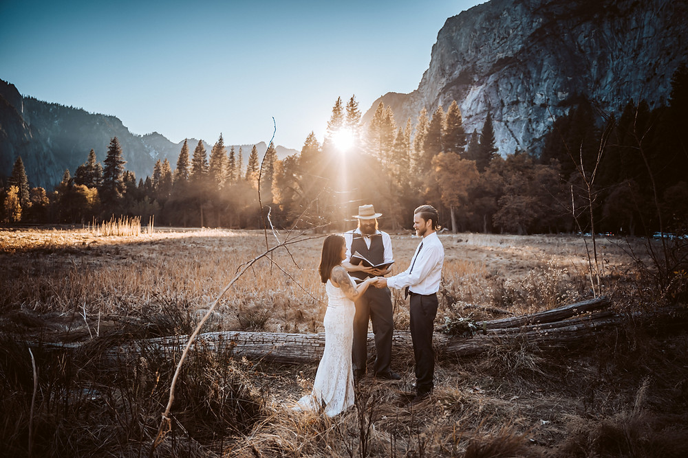 A couple that decided to elope in yosemite with an amazing sunset backdrop in the meadow.  This photo features a wedding elopement ceremony in Yosemite