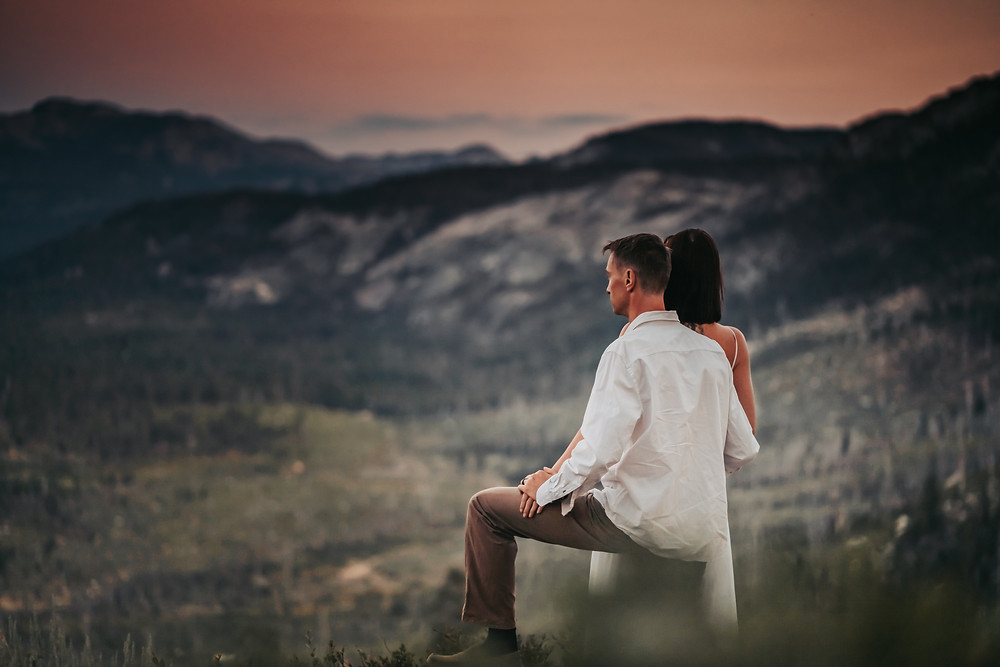 Bride and Groom overlooking the mountain range next to Lake Tahoe.  Photos is of eloping in Lake Tahoe.