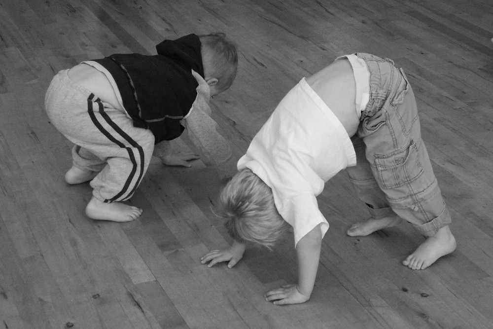 Toddlers exploring body shapes