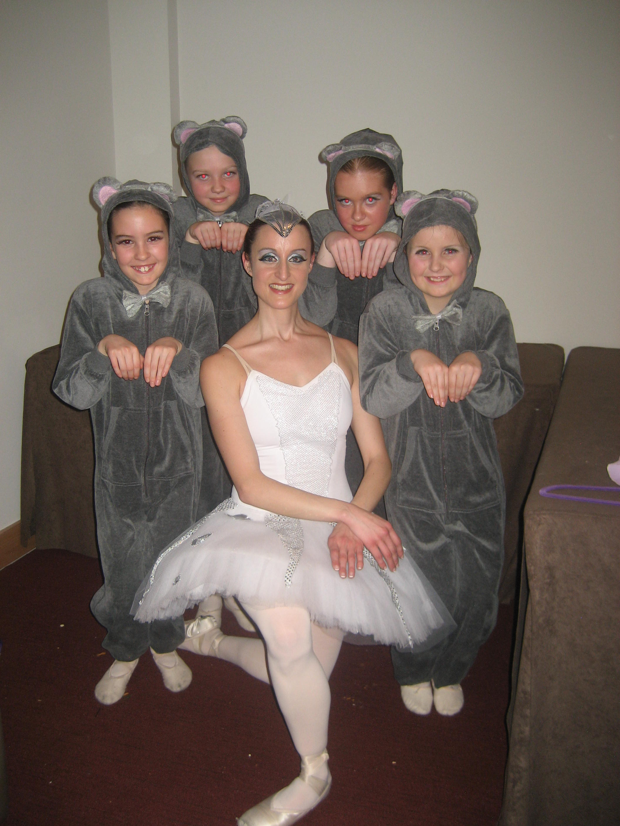 Rebecca dancing with some students in the Nutcracker