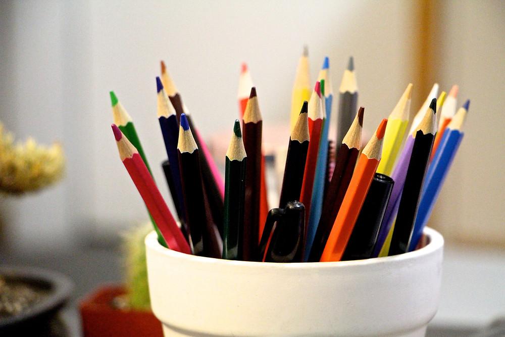 colour pencils in a mug