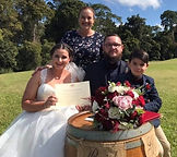 Claire and Nik.jpg. Wedding in the Gold Coast hinterlands. Happy couple holding their marriage certificate.