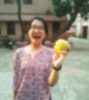 Hannah with tasty mango