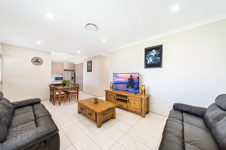 Marulan Stayz A Common Area Lounge and Kitchen Area