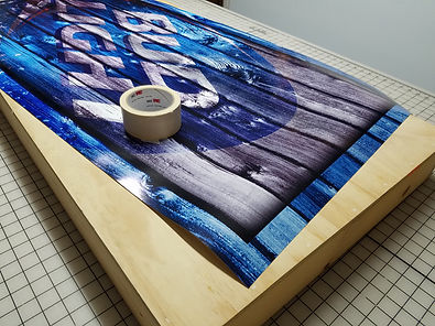 Lay down wrap and cut masking tape pieces