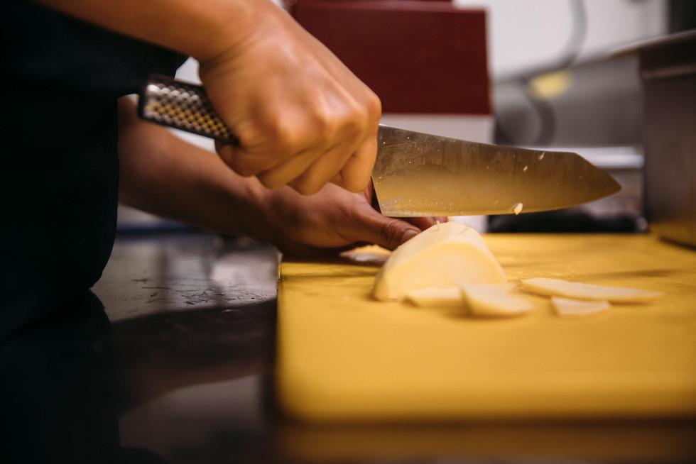 Christine cutting sweet potatoes