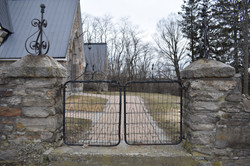 The gate outside the church.