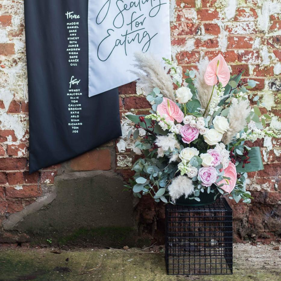 Photographer: Matt Glover / Signage: Handmade Sign Co. / Florist: Boon & Bloom