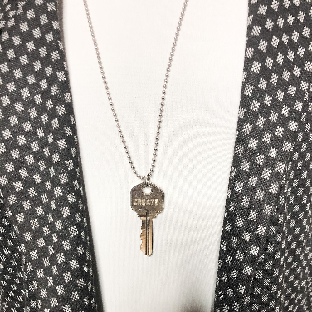 Engraved Key necklace from The Brave and Beautiful Boutique with the Lularoe Iris and Gwen Blazer
