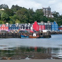 Tobermory, Scotland colorful row of shops.  Photo by Gina Duncan