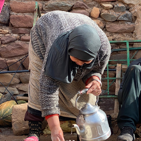 Baking bread at an Amazigh Village in Morocco High Atlas Mountains.   Photo by Gina Duncan