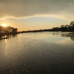Sunset at Western Lake, a coastal dune lake on 30A in the Gulf Coast of Florida. Photo by Gina Duncan