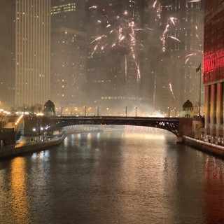Fireworks along the river on New Year's Eve in Chicago. Video by Gina Duncan