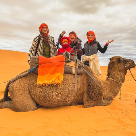 WorldTowning family in the Sahara Desert of Morocco. Photo by Gina Duncan