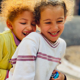 Best friends in an Amazigh Village of Morocco.  Photo by Gina Duncan