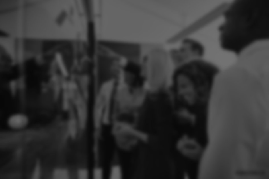 Blurred background image of a multi-ethnic team collaborating