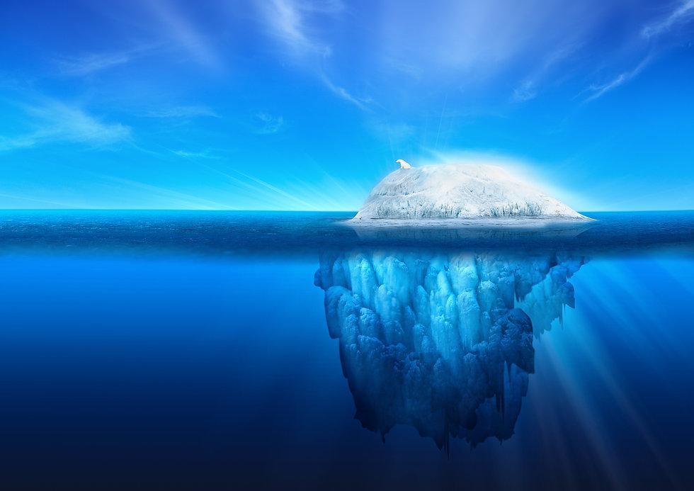 A polar bear on top of a natural iceberg