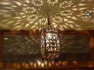 Moroccan lantern casts graphic shadows