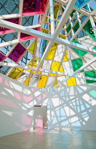 Colored glass and beams create huge colorful shadows