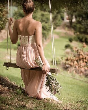 Woman on Swing Outdoor Wellness.jpg