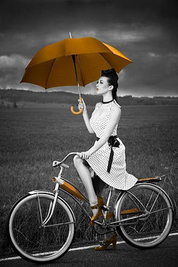 Woman on Bike black and white with splas