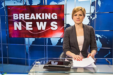 Newsreader-in-television-studio-69404107
