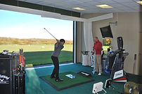 Lee Andrews giving a lesson in the coaching bays at Mid-Sussex Golf Club