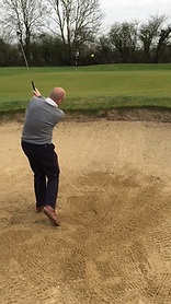Lee Andrews PGA professional showing finish position after hitting a golf ball out of a sand bunker