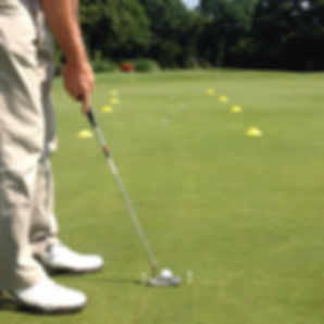 Lee Andrews PGA Professional working on putting distance control using cones