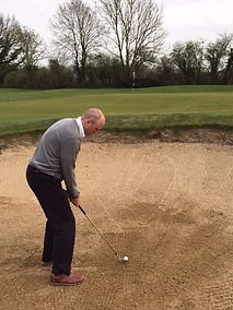 Lee Andrews PGA professional showing posture, stance and ball position for a sand bunker shot